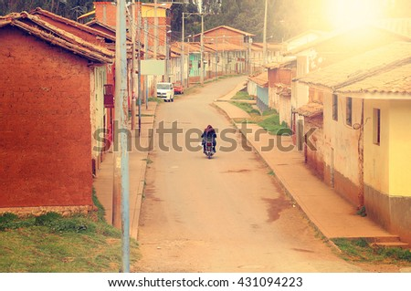 Empty street in typical village in Andes at sunset. Peru. - stock photo