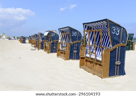 Empty sunbathing chairs on the beach. - stock photo