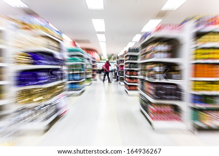 Empty supermarket aisle,motion blur - stock photo