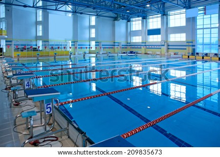 Empty swiming pool for competition. - stock photo