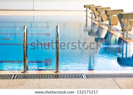 Empty swimming pool in university - stock photo