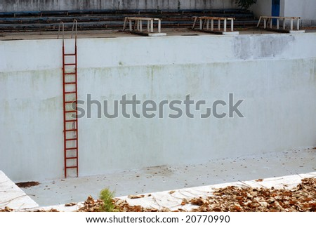 Empty swimming pool with leafs - stock photo
