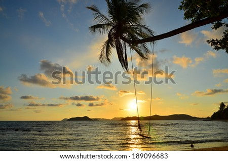 Empty Swing at Sunset Beach - stock photo
