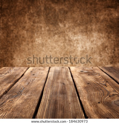 empty table and wall in dark interior space  - stock photo