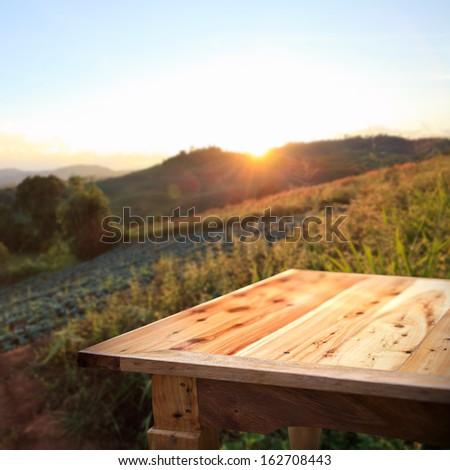 Empty table on Sunset - stock photo