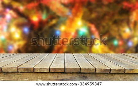 Empty table with christmas tree in background - stock photo