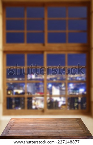 empty table with night view - stock photo