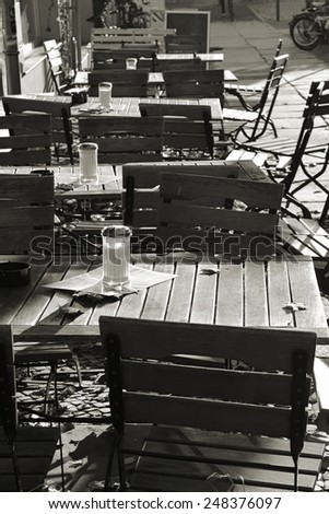 empty tables outside a restaurant - stock photo