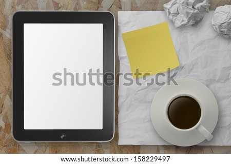 empty tablet pc and cup of coffee with sticky note on crumple paper as concept - stock photo