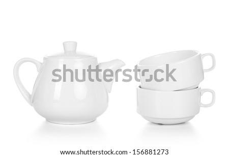 Empty tea cups with teapot isolated on white - stock photo