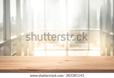 Empty the top of wood table with  blur  sunlight in window building.background.for product display and presentation - stock photo