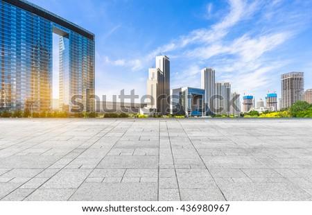 empty tiled floor and urban skyline,tianjin china. - stock photo