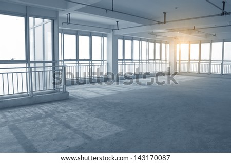 Empty to interior decoration ,An empty warehouse   - stock photo