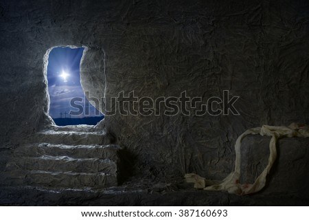 Empty tomb of Jesus at night with crosses in background - stock photo