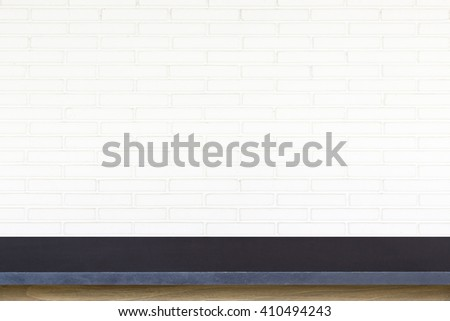 Empty top of stone table on white brick wall background. For product display - stock photo