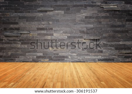 Empty top of wooden floor and natural stone wall background - stock photo
