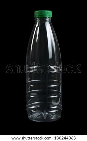 Empty transparent plastic bottle. Black isolated. Green cap - stock photo