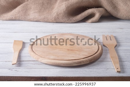Empty tray on wooden table - stock photo