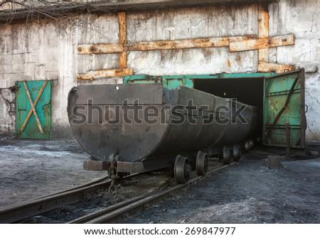 Empty trolley on mine yard. Ukraine, Uglegorsk - stock photo