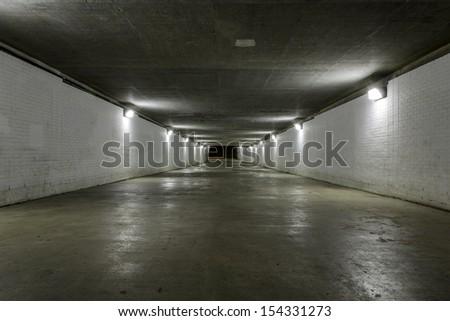 Empty tunnel at night - stock photo