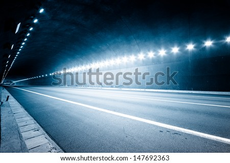 empty tunnel, blue toned image. - stock photo
