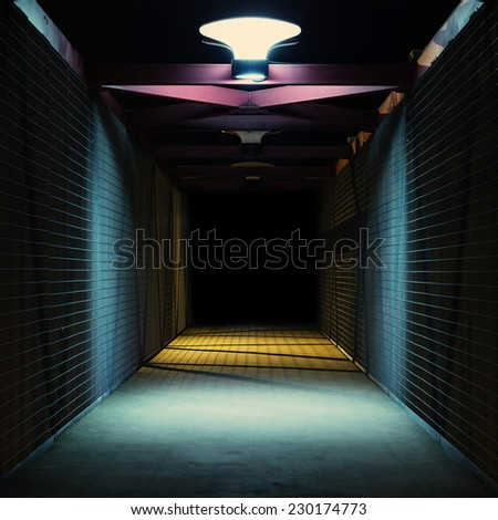 Empty urban night scene.  Metal bridge tunnel. - stock photo