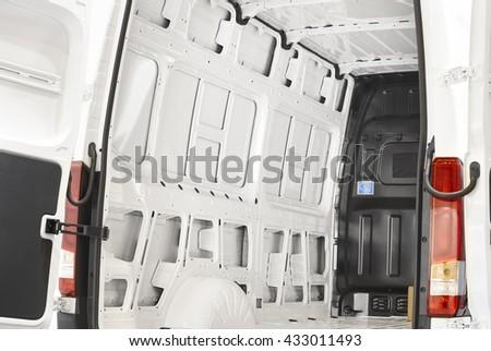 Empty van with open doors ready to be loaded. Horizontal - stock photo