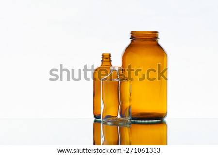 Empty various medicine bottles on the light background - stock photo
