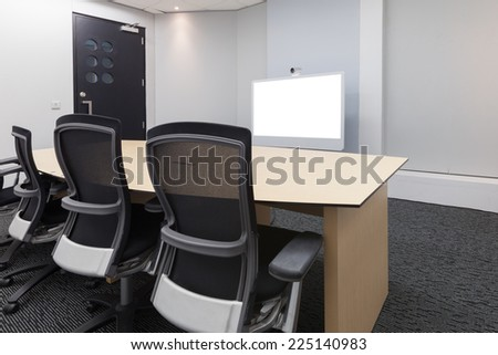 Empty video conference room with white screen focus at camera - stock photo