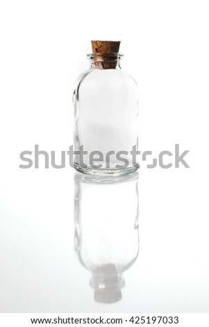 Empty vintage glass bottle isolated on white background with reflection - stock photo