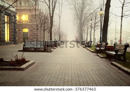 Empty walkway in the city - stock photo