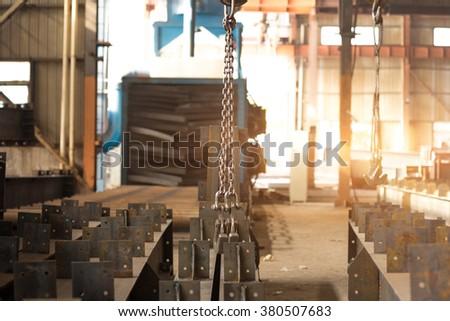 empty warehouse interior with crane hook - stock photo