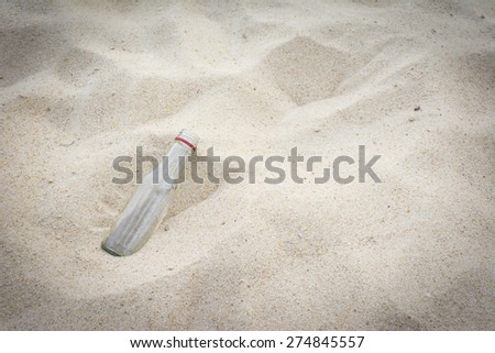 Empty water bottle on the beach background - stock photo
