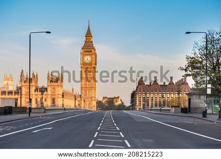 Empty Westminster Bridge and the Houses of Parliament with the Big Ben in London on a early summer morning. - stock photo