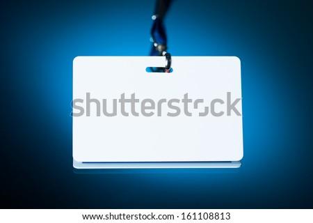 empty white badge backdrop against blue background - stock photo