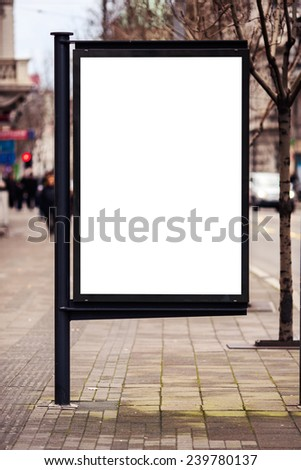 Empty white billboard on street. Toned photo - stock photo