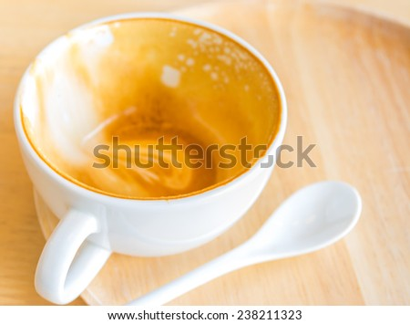 Empty white cup of hot coffee latte on  wooden table. - stock photo
