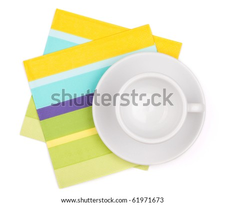 Empty white cup on color placemat. Isolated on white background - stock photo