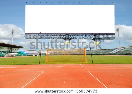 Empty white digital billboard screen for advertising in stadium and Running Trace, soccer field grass Goal at the stadium Soccer field - stock photo