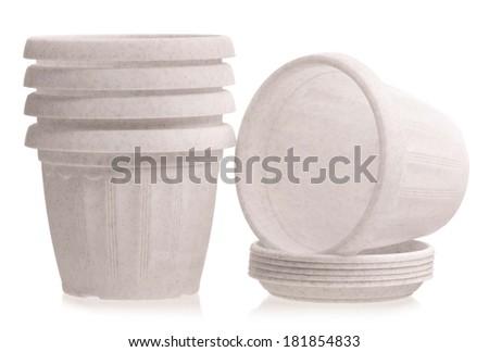 Empty white houseplant pots isolated on white background  - stock photo