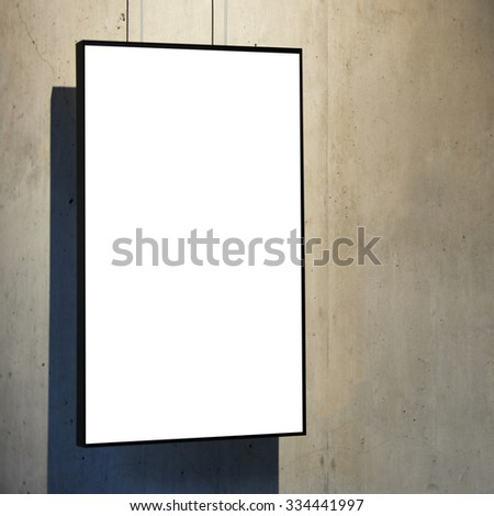 Empty white isolated frame on the wall - stock photo