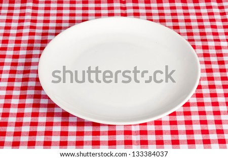 Empty white plate on the table - stock photo