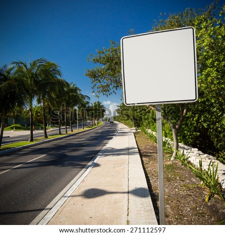 Empty white road sign. Tropical street - stock photo