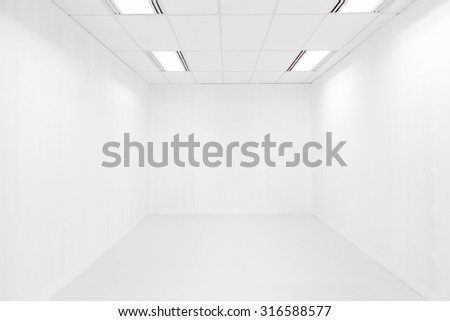 Empty white room and ceiling light - stock photo