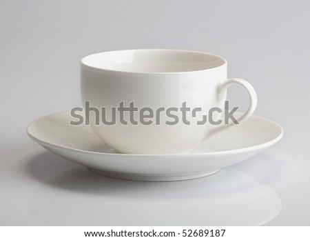 Empty white tea cup and saucer - stock photo