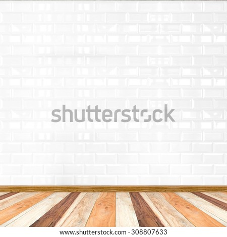 Empty white tile wall and wooden flooring,mock up for display of product. - stock photo