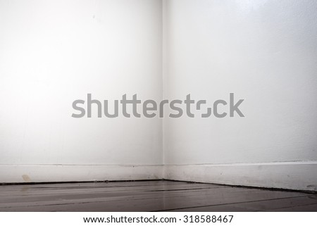 Empty white wall and dark brown parquet floor in perspective view - stock photo