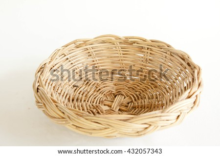 Empty wicker basket on white background - stock photo