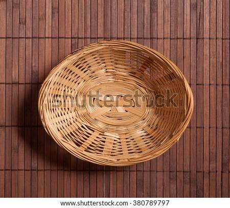 Empty wicker basket top view - stock photo