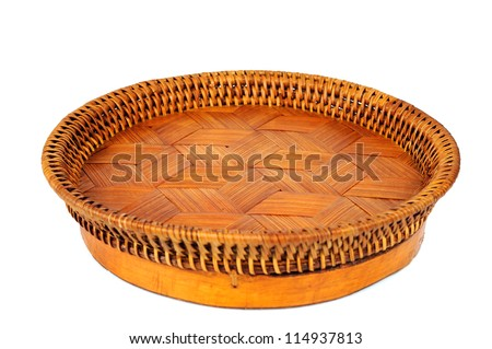 Empty wicker tray isolated on white background - stock photo